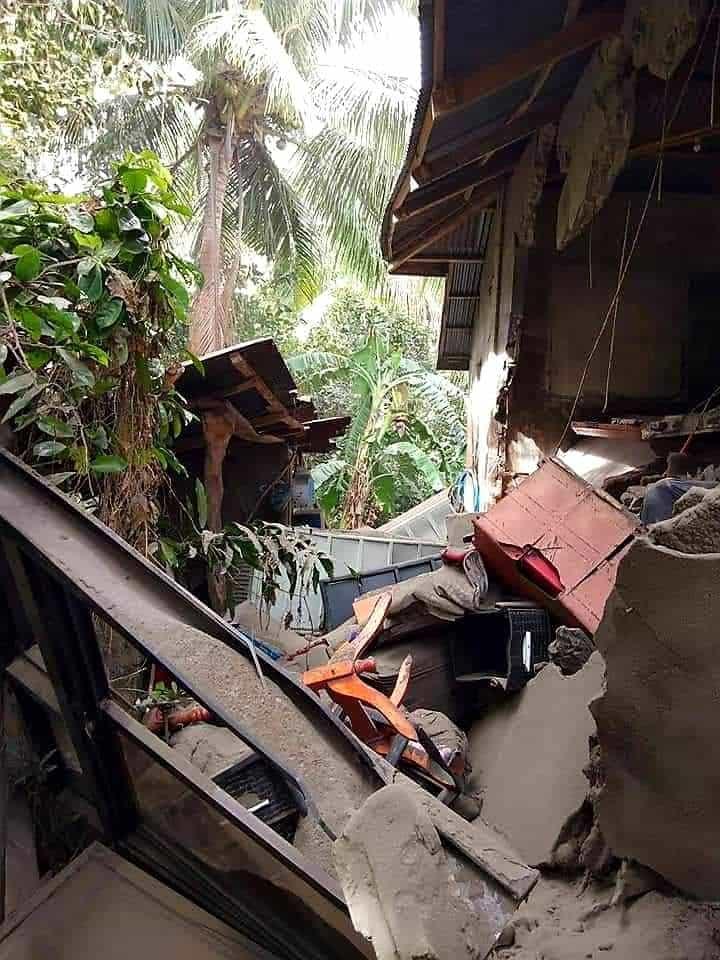 Furniture that has fallen out a broken wall