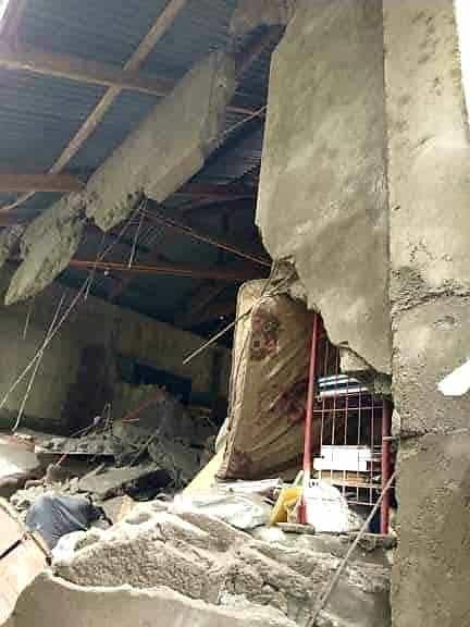 Destroyed wall showing a broken mattress