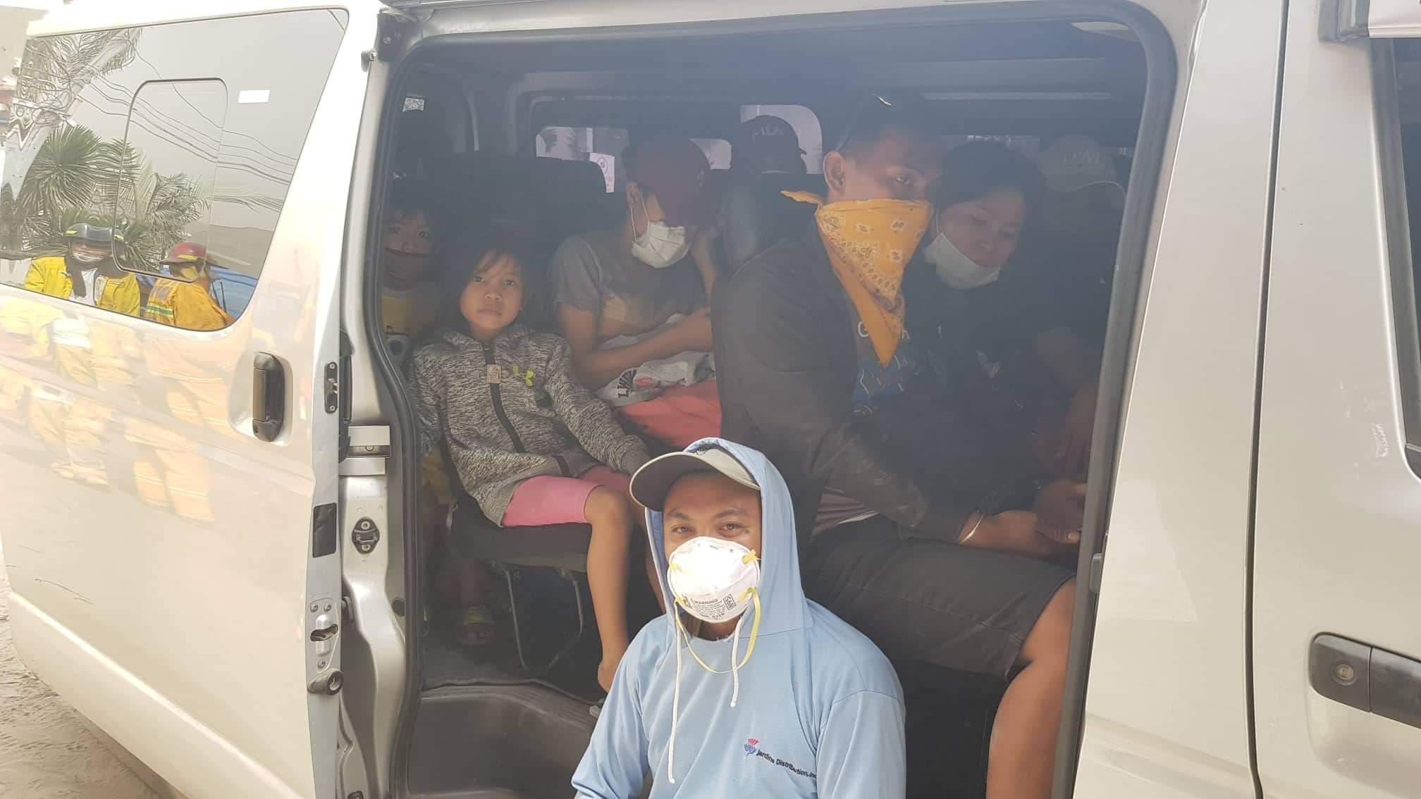 People wearing air masks in a van