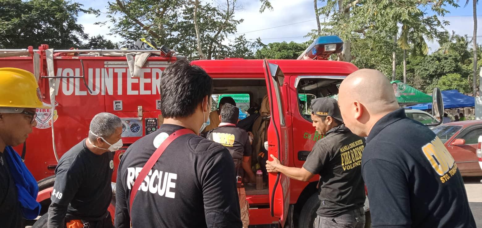 Firemen in front of fire truck